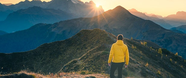 Man at sunrise in mountains
