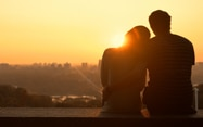 Image of couple looking at sunset