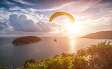 Paraglider over water