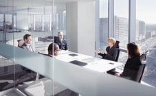People talking around conference room table
